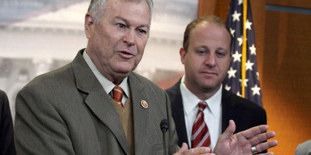 Rep. Dana Rohrabacher, R-Calif., left, accompanied by Rep. Jared Polis, D-Colo., speaks during a news conference on Capitol H