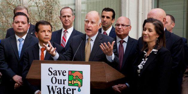 Gov. Jerry Brown talks during a news conference after meeting with several California mayors to discuss water conservation at