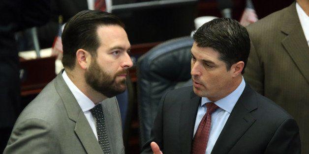 House speaker Steve Crisafulli, R-Merritt Island, left, confers with Rep. Jose Diaz, R-Miami-Dade county, during a legislativ