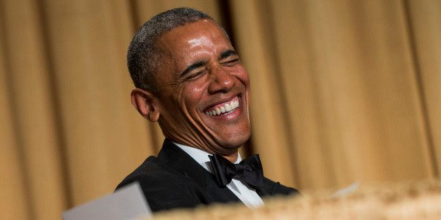 President Barack Obama laughs at a joke during the White House Correspondents' Association dinner at the Washington Hilton on