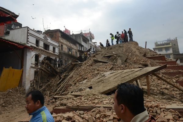 People clear rubble in Kathmandu's Durbar Square, a UNESCO World Heritage Site that was severely damaged by an earthquake on