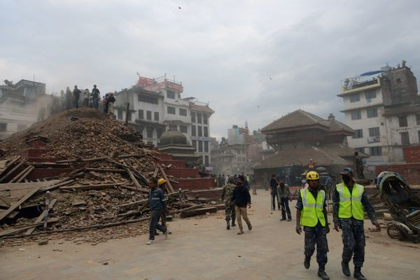 Nepalese rescue workers and onlookers gather at Kathmandu's Durbar Square, a UNESCO World Heritage Site that was severely dam