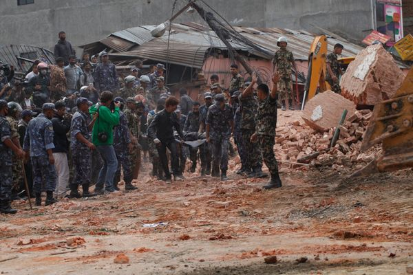 KATHMANDU, NEPAL - APRIL 25: (EDITORS NOTE: Image is highest resolution available.) Rescuers, polce and army personnel search