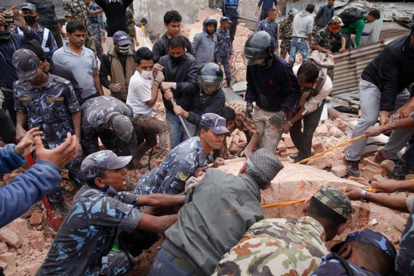KATHMANDU, NEPAL - APRIL 25:  Police and rescuers search for survivors in the debris of the Dharahara Tower on April 25, 2015