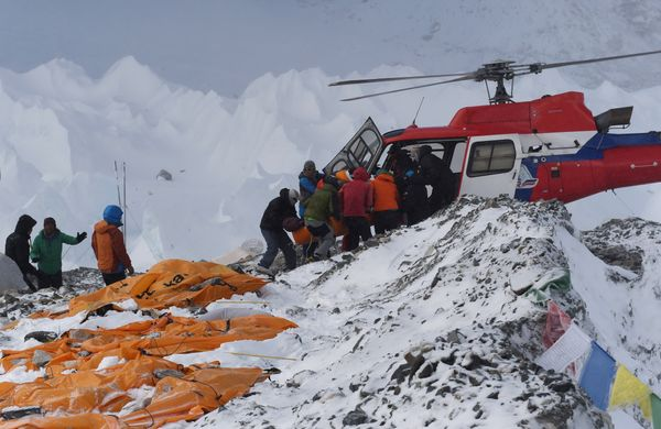 An injured person is loaded onto a rescue helicopter at Everest Base Camp on April 26, 2015, a day after an avalanche trigger