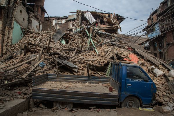 BHAKTAPUR, NEPAL - APRIL 26:  A truck is covered in debris from a collapsed building on April 26, 2015 in Bhaktapur, Nepal. A