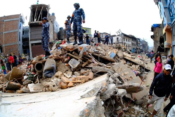 KATHMANDU, NEPAL - APRIL 26: Search and rescue team work among the debris of houses after a powerful earthquake hits Katmandu
