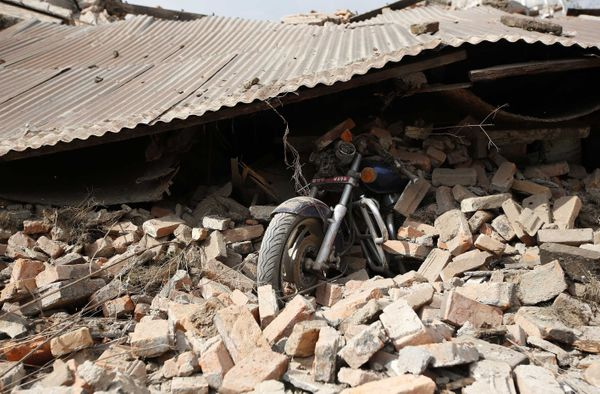 KATHMANDU, NEPAL - APRIL 26: A motorbike is buried under debris of destroyed buildings in Katmandu, Nepal on April 26, 2015.