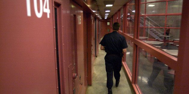 ** FILE ** A guard walks down past prisoner cells at the Connecticut Supermax facility called Northern Correctional Instituti