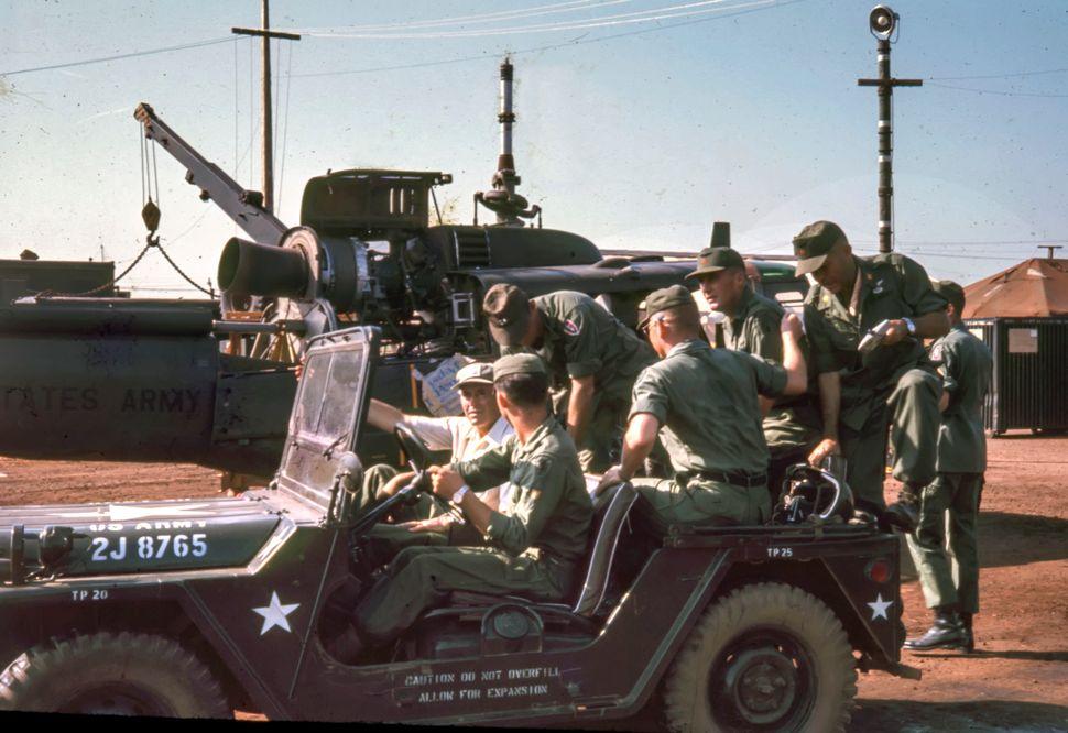 Soldiers surrounding Henry Fonda.