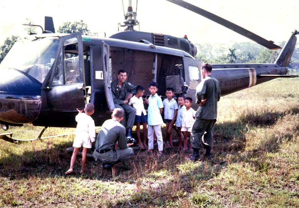 Soldiers surrounded by children after landing.