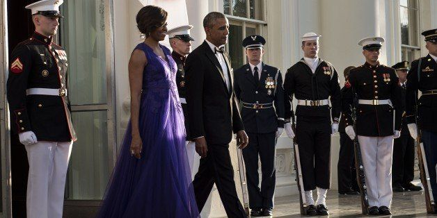US First Lady Michelle Obama and US President Barack Obama arrive to greet Japan's Prime Minister to the White House for a st