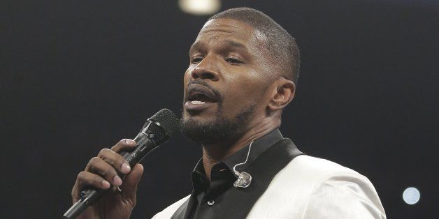 Actor Jamie Foxx sings the national anthem before the start of the world welterweight championship bout between Floyd Mayweat