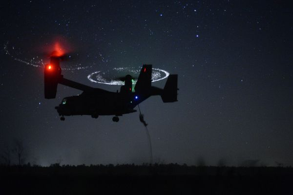 Combat controllers from the 21st Special Tactics Squadron fast-rope from a CV-22 Osprey during Emerald Warrior near Hurlburt