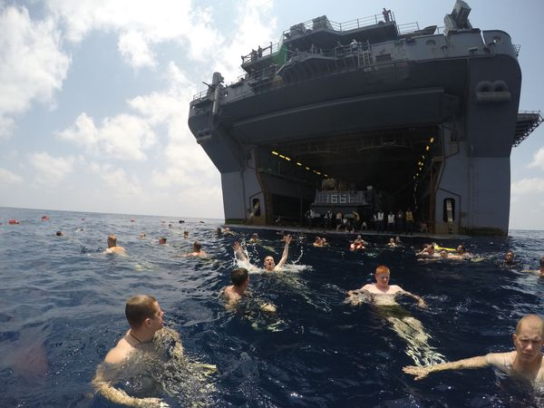 Sailors and Marines aboard the amphibious assault ship USS Iwo Jima participate in a swim call in the Gulf of Aden, April 18,