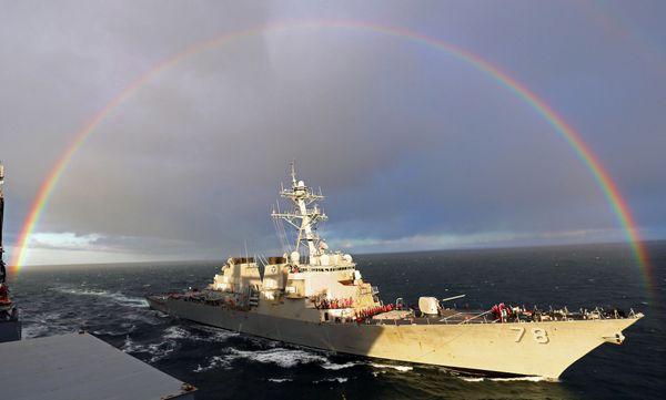 The guided-missile destroyer USS Porter (DDG 78) pulls alongside the Military Sealift Command dry cargo and ammunition ship U