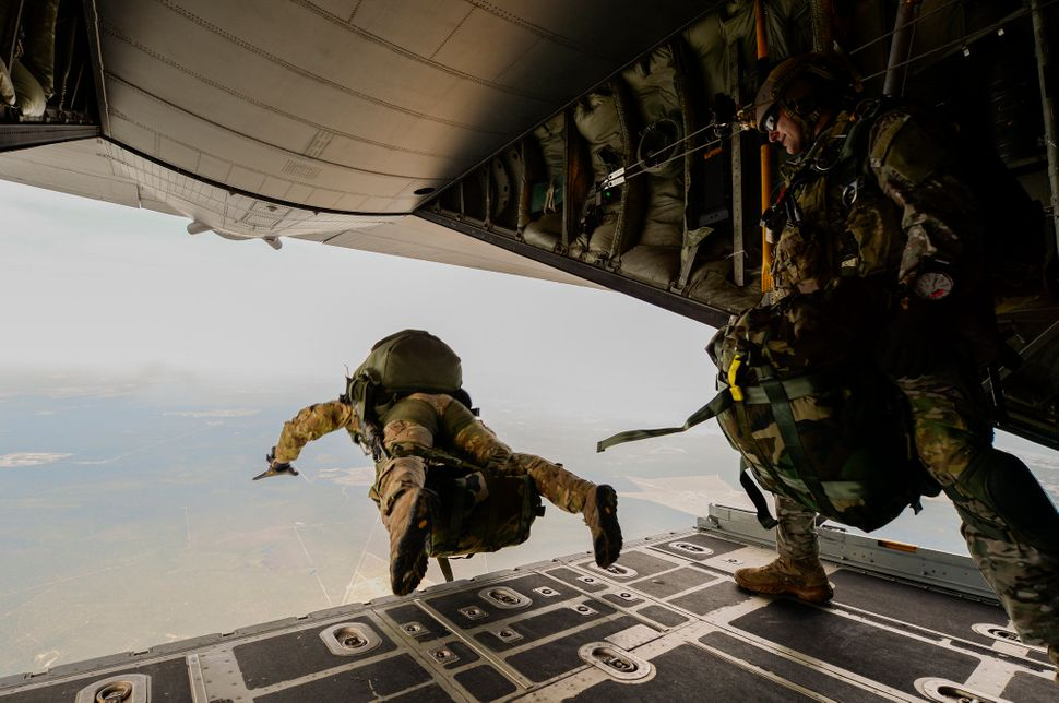 U.S. Army Green Berets from the 7th Special Forces Group jump out of a C-130H3 Hercules for Emerald Warrior at Hurlburt Field