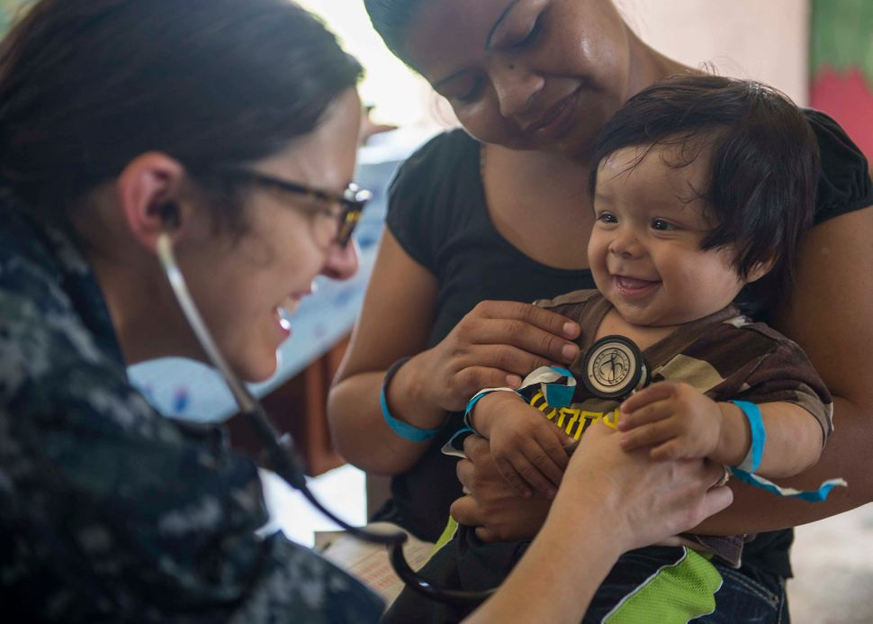 Lt Cmdr. Melissa Buryl, from Canton, Ohio, a pediatrician stationed at Naval Medical Center Portsmouth, Virginia, checks a ch