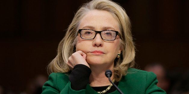 Secretary of State Hillary Rodham listens as she testifies on Capitol Hill in Washington, Wednesday, Jan. 23, 2013, before th