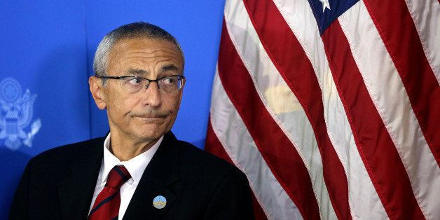 Counselor to U.S. president John D. Podesta listens during a news conference at the U.S. embassy in Kabul, Afghanistan, Monda