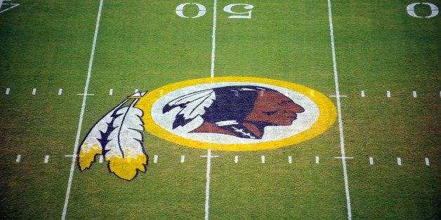 FILE - In this Aug. 28, 2009 file photo, the Washington Redskins logo is shown on the field before the start of a preseason N