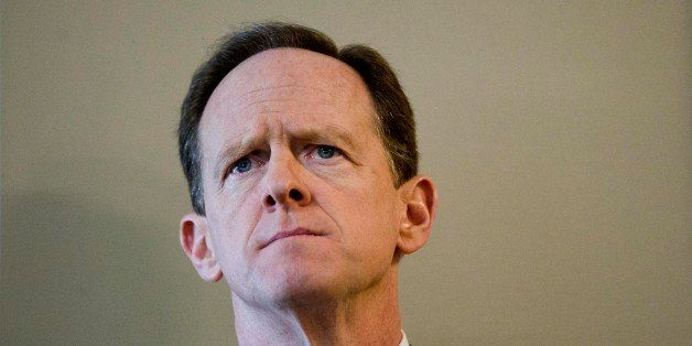 Sen. Pat Toomey, R-Pa.,, listens during a news conference Monday, Feb. 10, 2014, at a Fraternal Order of Police lodge in Phil