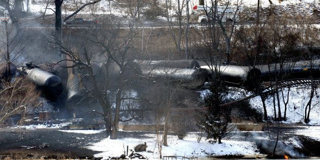 FILE-This Feb. 17, 2015 file photo, shows a train derailment that sent a tanker with crude oil into the Kanawha River near Mo