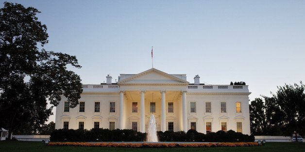 A October 20, 2013 photo shows the White House as seen from Pennsylvania Avenue as the sun sets on October 20, 2013 in Washin