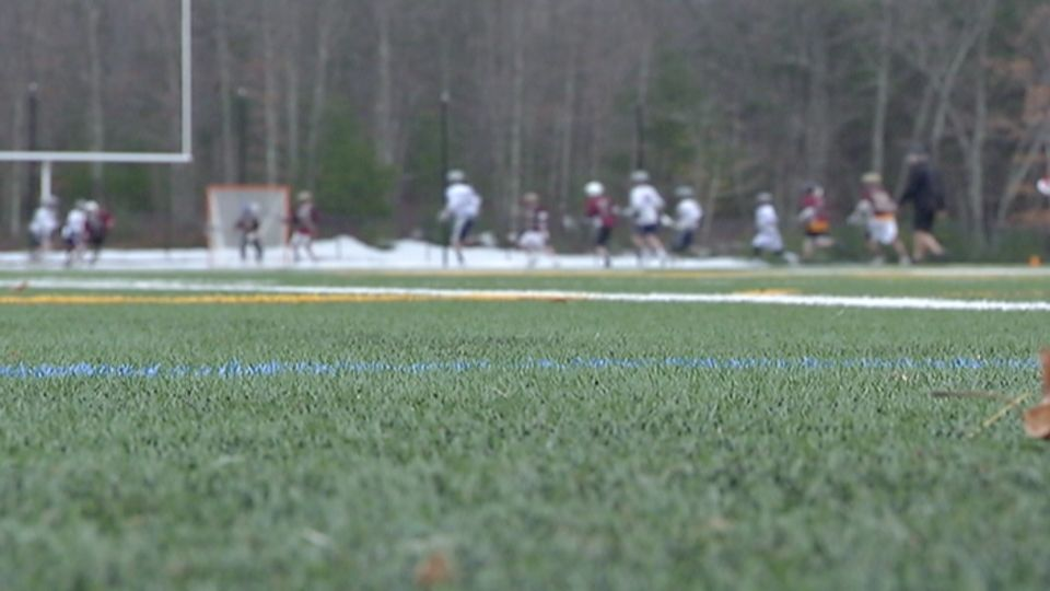 Medway High School's brilliant green artificial turf field uses controversial crumb rubber -- chopped up tires, that sometime