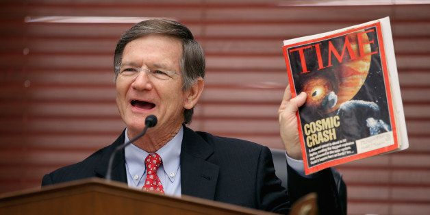 WASHINGTON, DC - MARCH 19:  House Science, Space and Technology Committee Chairman Lamar Smith (R-TX) holds up a copy of TIME