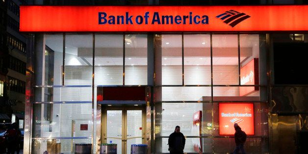 In this Jan. 14, 2015 photo, people walk past a branch of Bank of America, in New York. The Federal Reserve on Wednesday, Mar
