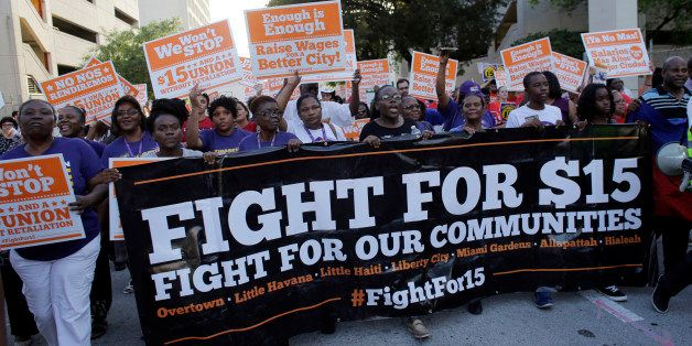Protestors march in support of raising the minimum wage to $15 an hour as part of an expanding national movement known as  Fi