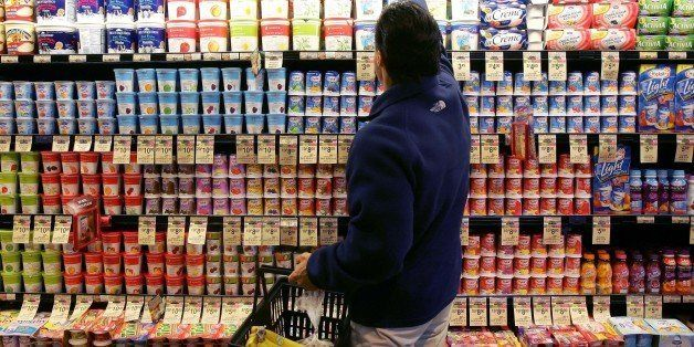 **FILE** A man shops in the yogurt aisle at a Safeway store in San Francisco in this July 18, 2006 file photo. Grocery store