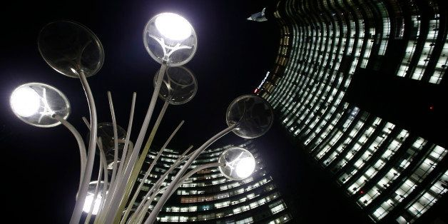 The UniCredit headquarters building towers over Milan's business center, Italy, Tuesday, Nov. 11 , 2014. The recent Europe-wi
