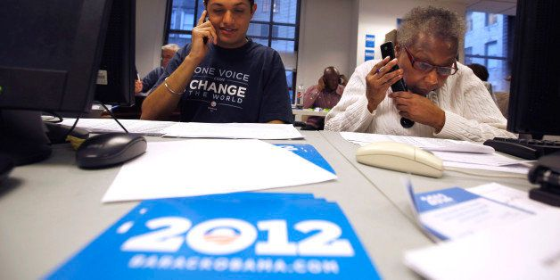 Volunteers Sukhdeep Singh, left, and Barbara Williams work a phone bank at Obama For America's Philadelphia headquarters in P