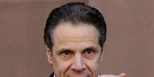 New York Gov. Andrew Cuomo points to supporters in New York, Wednesday, April 29, 2015. New York state will end its AIDS epid