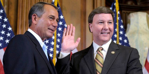 House Speaker John Boehner of Ohio reenacts the swearing in of Rep. Mike Rogers, R-Ala., Wednesday, Jan. 5, 2011, on Capitol