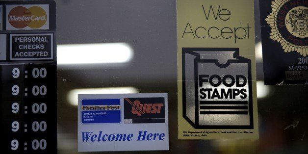 A supermarket displays stickers indicating they accept food stamps in West New York, N.J., Monday, Jan. 12, 2015. New Jersey