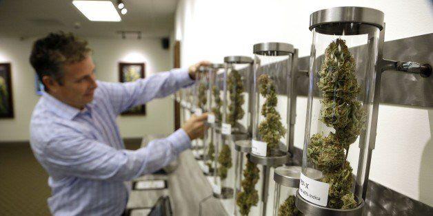 In this Wednesday, Nov. 5, 2014 photo, Shane McKee, co-founder of Shango Premium Cannabis medical marijuana dispensary, pulls