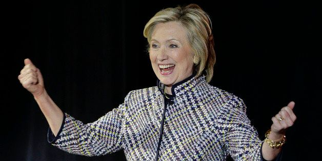 Hillary Rodham Clinton reacts to applause from the crowd before speaking during the sixth annual Women in the World Summit, T