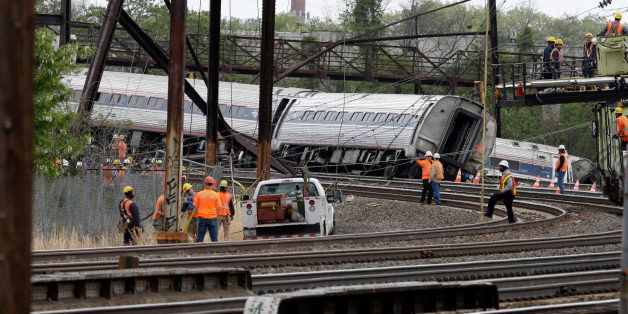 Emergency personnel gather near the scene of a deadly train wreck, Wednesday, May 13, 2015,  after a fatal Amtrak derailment