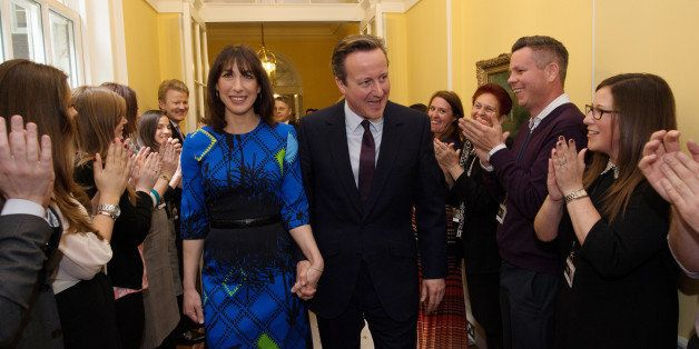 LONDON, ENGLAND - MAY 08:  Prime Minister David Cameron and his wife Samantha Cameron are applauded by staff upon entering 10