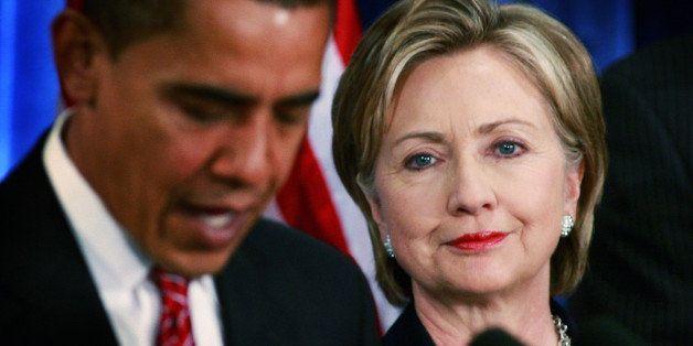 CHICAGO - DECEMBER 01:  President-elect Barack Obama (L) introduces Senator Hillary Clinton (D-NY) as his choice for secretar