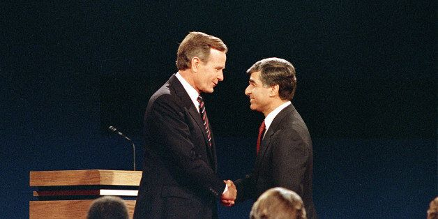 Democratic candidate and Massachusetts Gov. Michael Dukakis shakes hands with Vice President and Republican candidate George
