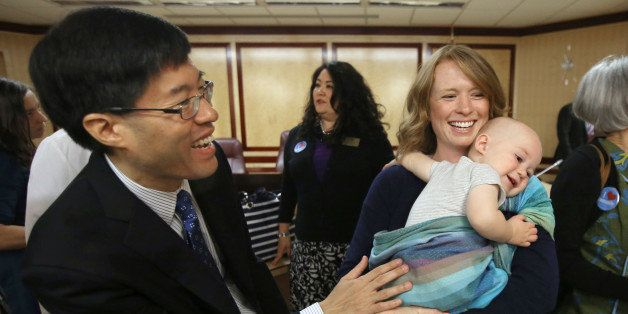 Sen Richard Pan, D-Sacramento, left, talks with Jennifer Wonnacott, a supporter of Pan's measure requiring California schoolc