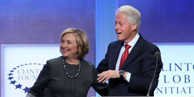 Former Secretary of State Hillary Rodham Clinton and former U.S. President Bill Clinton appear together on stage during a ple