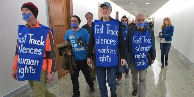 Demonstrators gather in the Dirksen Senate Office Building before a silent protest against 'Flood Congress: Opponets of Fast