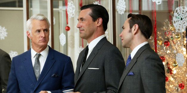 This publicity image released by AMC shows John Slattery as Roger Sterling, left, Jon Hamm as Don Draper, center, and Vincent