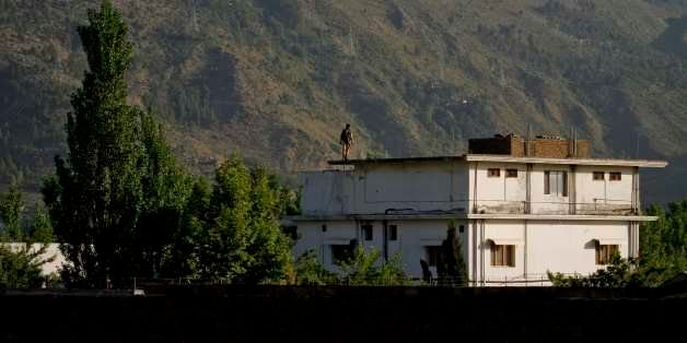 FILE - In this May 6, 2011 file photo, a Pakistan army soldier stands on top of the house where it is believed al-Qaida leade
