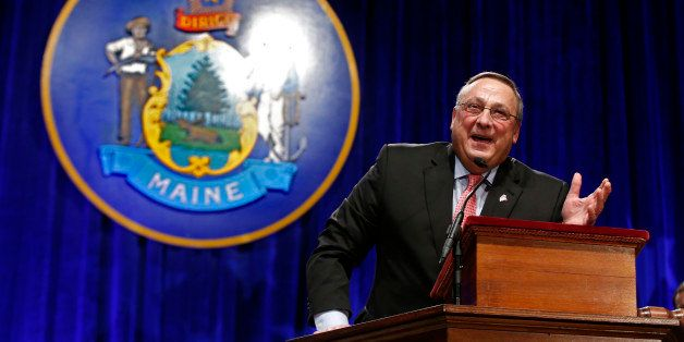 Republican Gov. Paul LePage returns to the podium after delivering his inauguration address to joke about how he noticed many